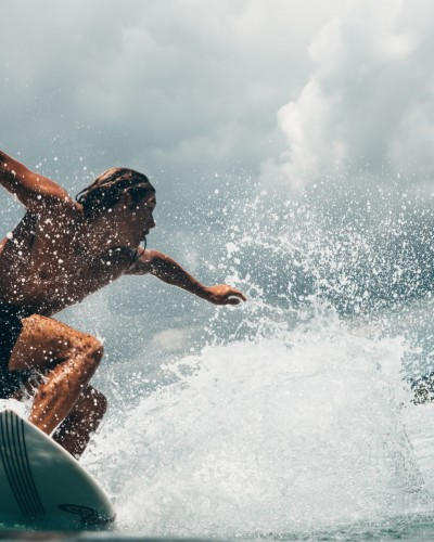 man-riding-white-surfboard-1005456